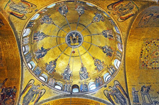 The Pentecost Mosaic, in the center of which is the dove of the Holy Spirit with the twelve apostles below. This is one of the oldest mosaics in St. Mark's Basilica, in Venice, dating from 1125 AD.